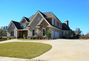Home in Rockwall with a concrete driveway.